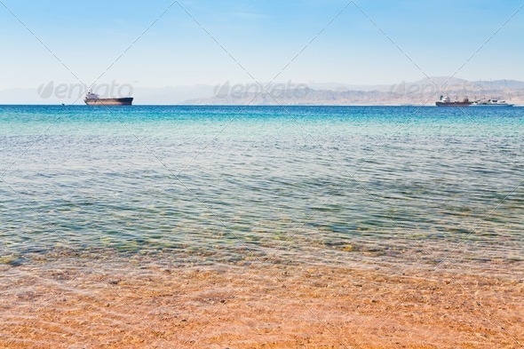 view on Israel mountain through Red Sea from Aqaba port - Stock Photo - Images