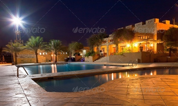 open-air swimming pool at night - Stock Photo - Images
