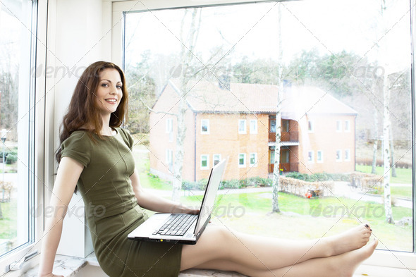 Girl at window - Stock Photo - Images