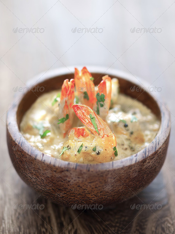 shrimps in tomato cream curry sauce - Stock Photo - Images