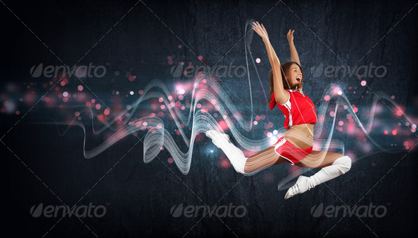 Young woman dancer. With lights effect. - Stock Photo - Images