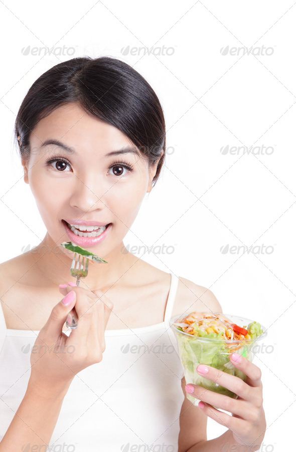 Young Girl Smile eating salad - Stock Photo - Images