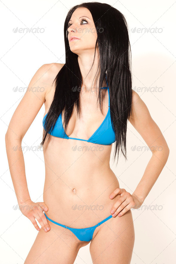 Sexy black haired slim woman in blue micro bikini on white isolated background - Stock Photo - Images