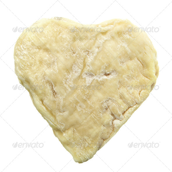 Heart shape moldy goat cheese isolated on white background - Stock Photo - Images