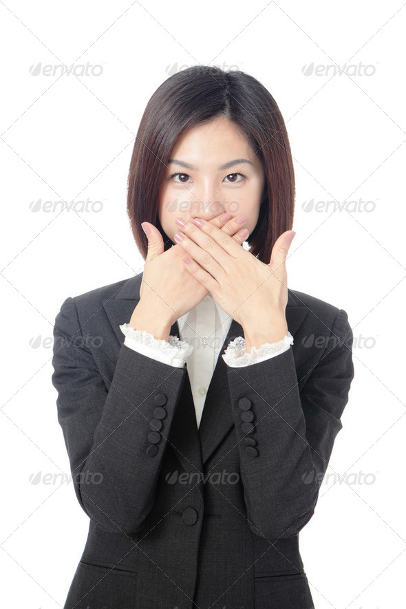 business woman covering with hands her mouth - Stock Photo - Images