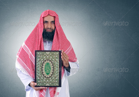 "Islamic Arabian Shiekh presenting the holy book of Islam "" Quran "" - Stock Photo - Images"