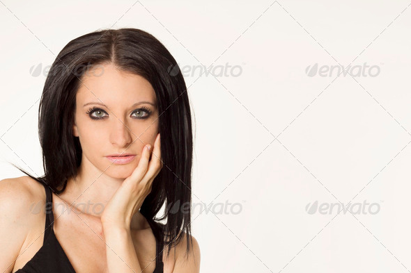 DoraBlack haired beautiful woman portrait on white isolated background  - Stock Photo - Images