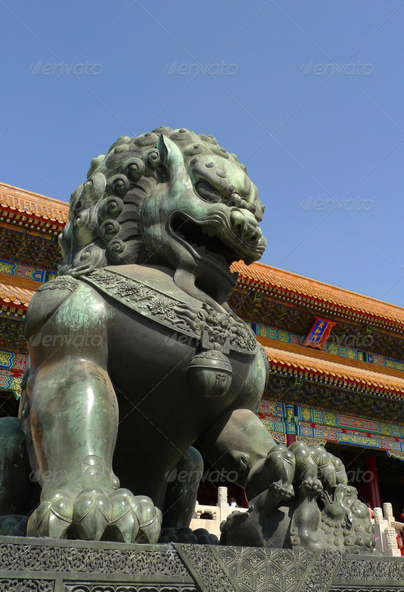 An imperial guardian lion the Forbidden City in Beijing - Stock Photo - Images