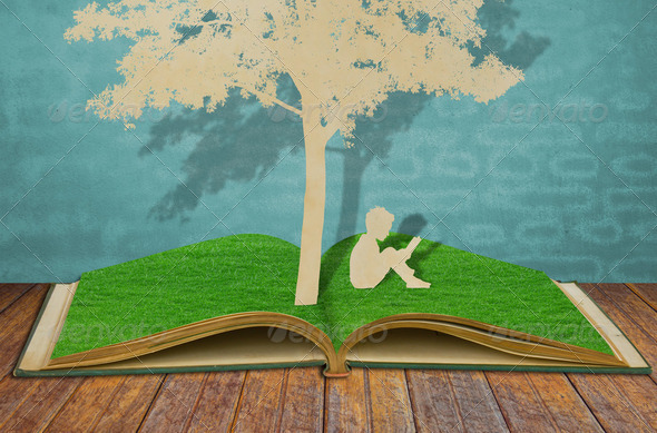 Paper cut of children read a book under tree on old book - Stock Photo - Images