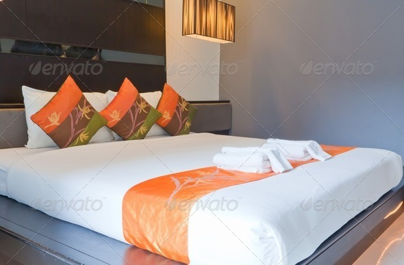 Hotel room with bed and wooden - Stock Photo - Images