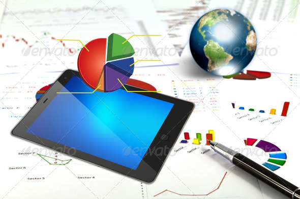Touch pad and financial Graphs - Stock Photo - Images