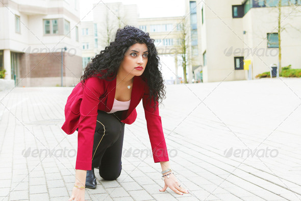 Business race: young woman in the run - Stock Photo - Images