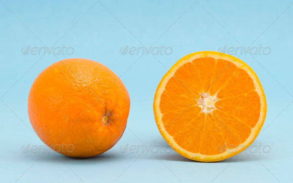 Orange healthy nutrition fruits  blue background - Stock Photo - Images