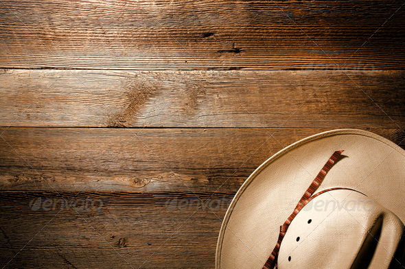 american west rodeo cowboy hat on wood background stock photo by olivierlequeinec. Black Bedroom Furniture Sets. Home Design Ideas