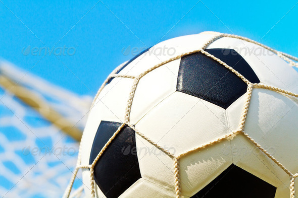 Soccer ball in net - Stock Photo - Images