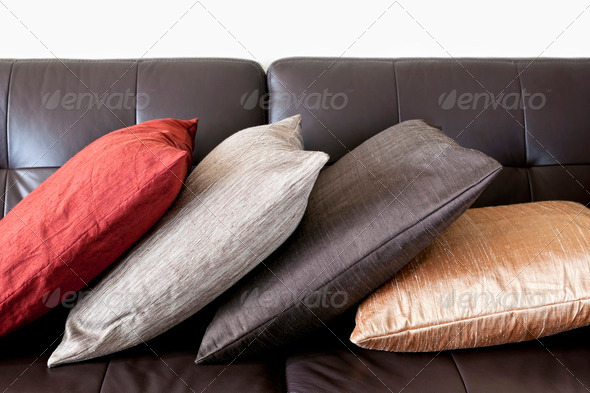 Cushions on leather sofa - Stock Photo - Images