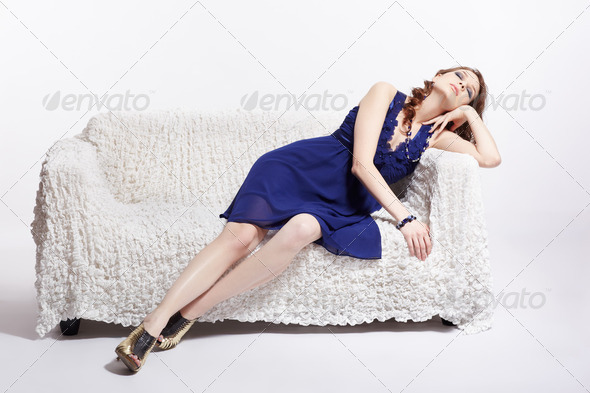 woman relaxing on sofa - Stock Photo - Images