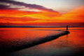 Man Walking on Beach at Sunset - PhotoDune Item for Sale