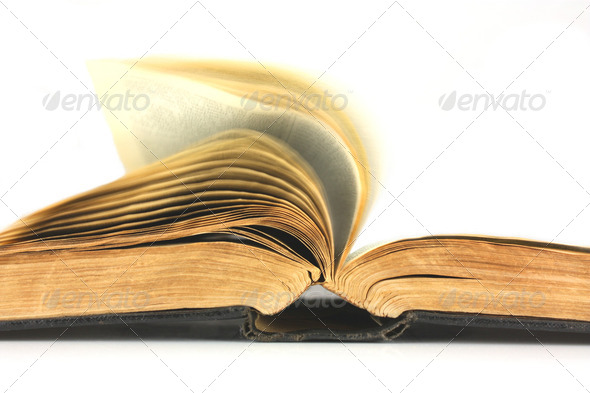 Old book turning pages over - Stock Photo - Images