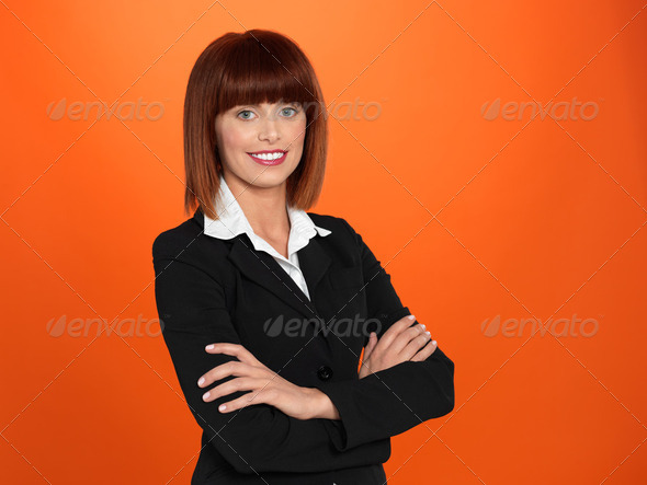 beautiful, young businesswoman with arms crossed - Stock Photo - Images