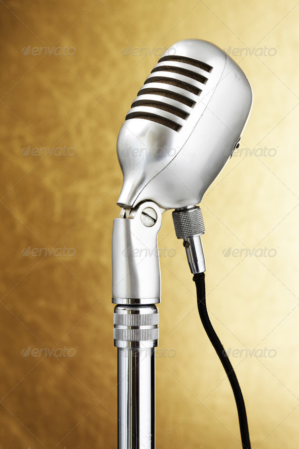 Retro style microphone. Gold background - Stock Photo - Images