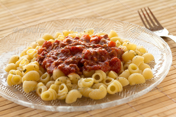 Lumache pasta with bolognese sauce - Stock Photo - Images