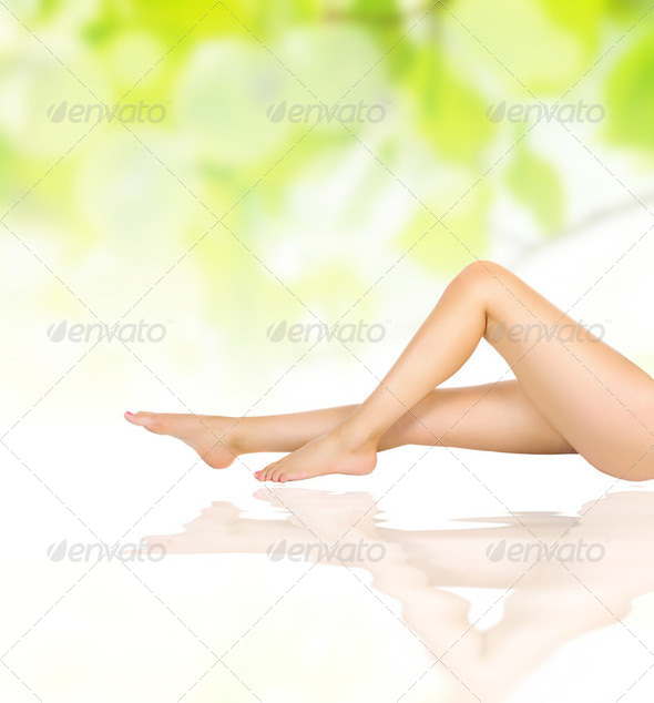 female legs on water waves over green - Stock Photo - Images