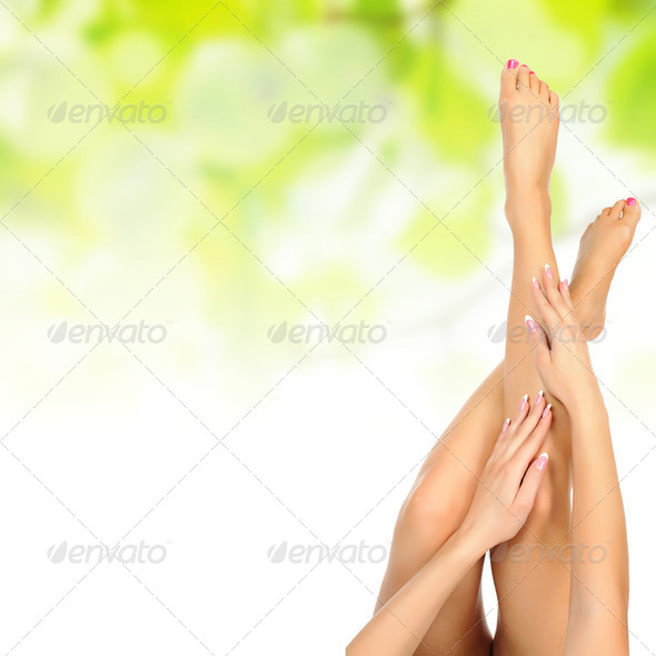 female legs being massaged over green - Stock Photo - Images