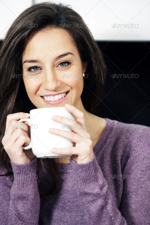 Portrait of a cute young lady with a cup of coffee - Stock Photo - Images