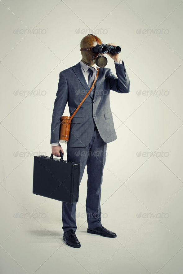 Businessman with gas mask  looking through binoculars - Stock Photo - Images