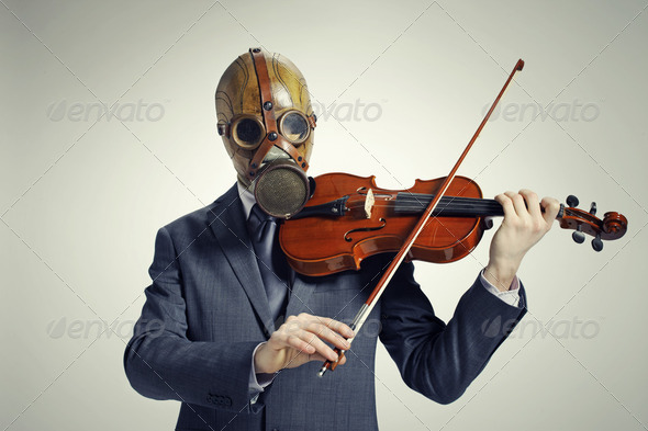 businessman with gas mask, plays the violin - Stock Photo - Images