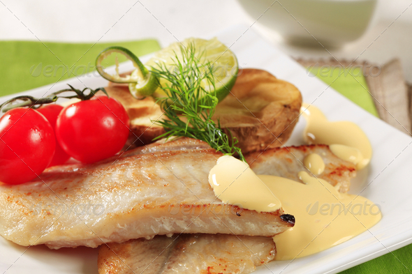 Pan fried fish fillets - Stock Photo - Images