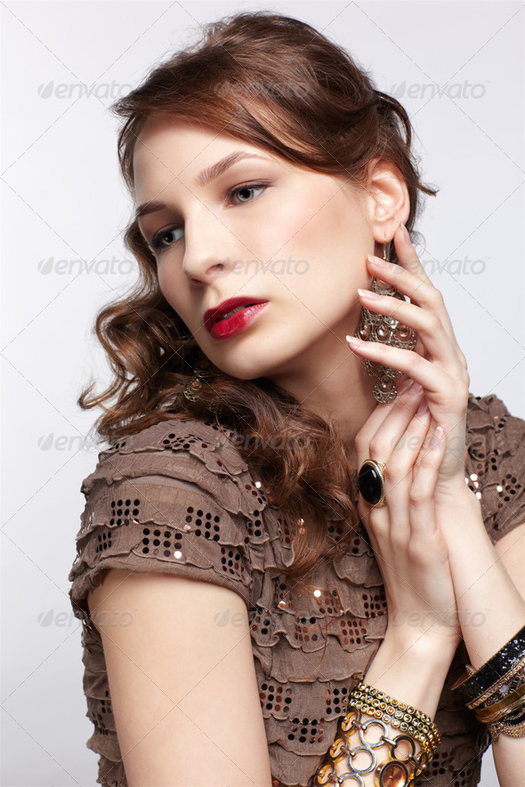 beautiful brunette in jewellery - Stock Photo - Images