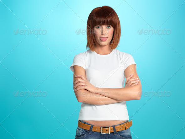 funny, pretty woman showing her tongue - Stock Photo - Images