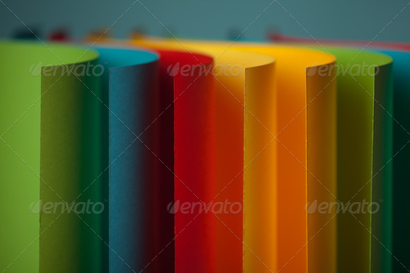 abstract colored paper structure on blue background - Stock Photo - Images