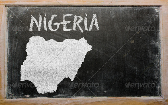 outline map of nigeria on blackboard - Stock Photo - Images