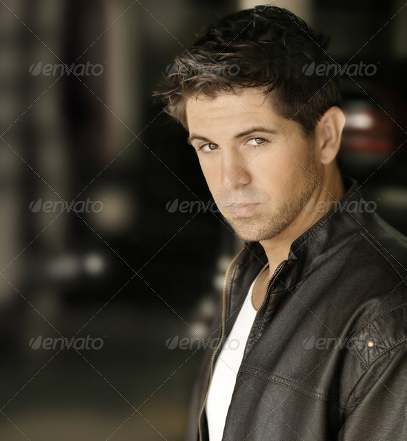 Portrait of a sexy young man in leather jacket - Stock Photo - Images