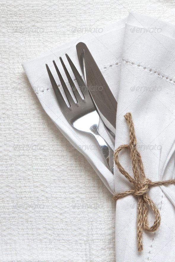 White linen napkin and cutlery - Stock Photo - Images