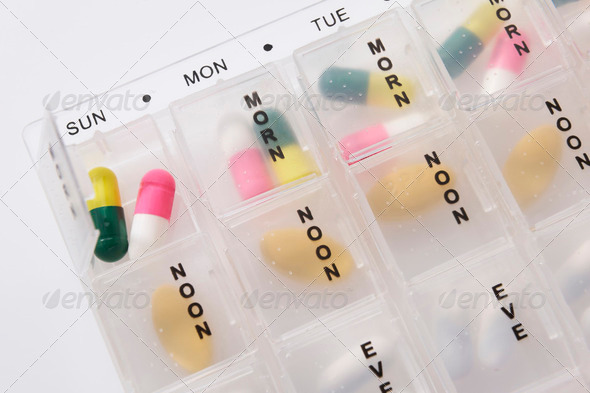 Seven day medicine chest - Stock Photo - Images
