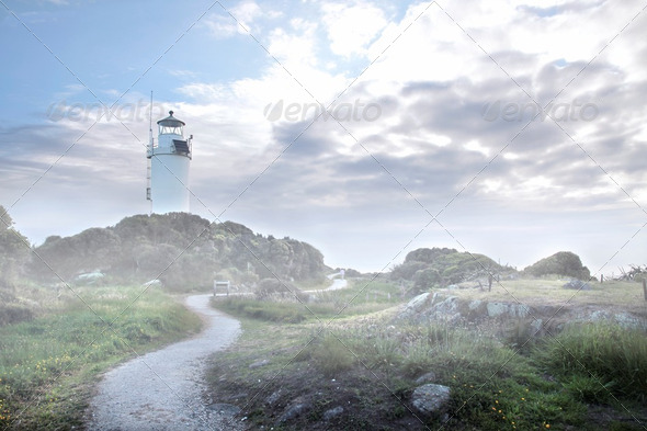 Cape Foulwind Lighthouse in the fog - Stock Photo - Images
