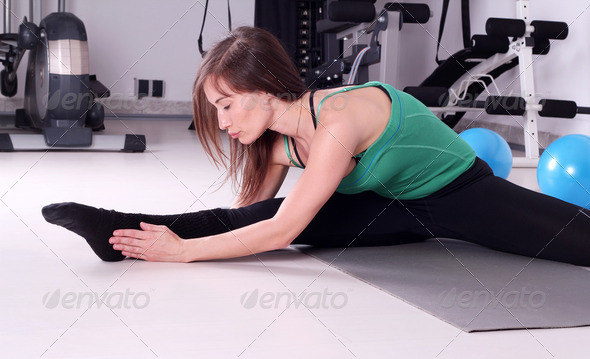 Girl stretching fitness exercise - Stock Photo - Images