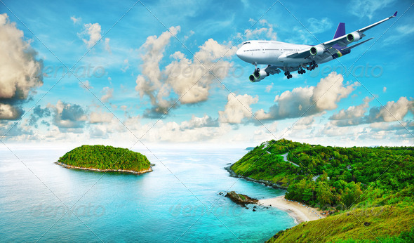 Jet liner over the tropical island - Stock Photo - Images
