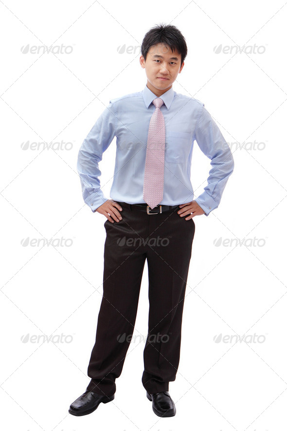 full length business man with confident smile - Stock Photo - Images
