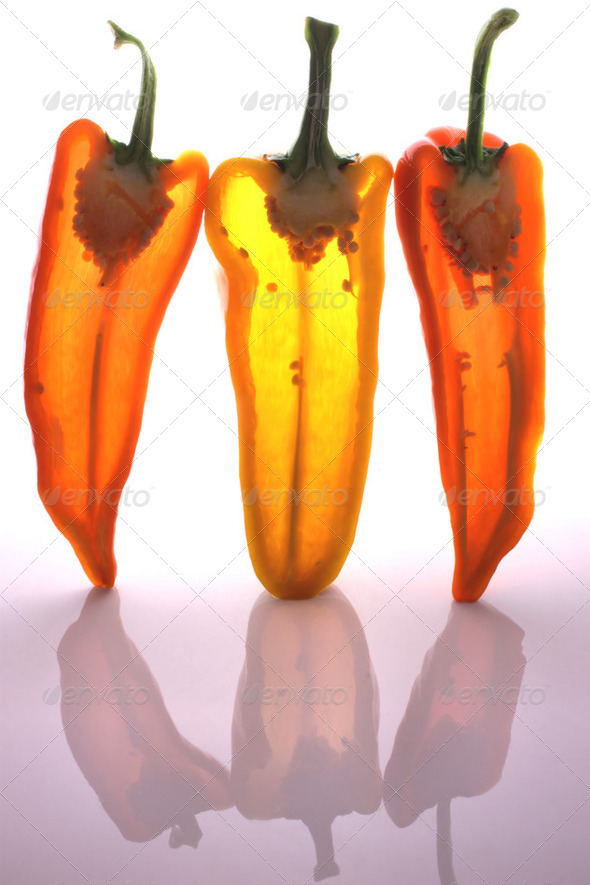 Peppers in half with light through them - Stock Photo - Images
