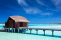 Overwater villas in blue lagoon of an island - PhotoDune Item for Sale