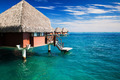 Over water bungalow with steps into clear ocean - PhotoDune Item for Sale