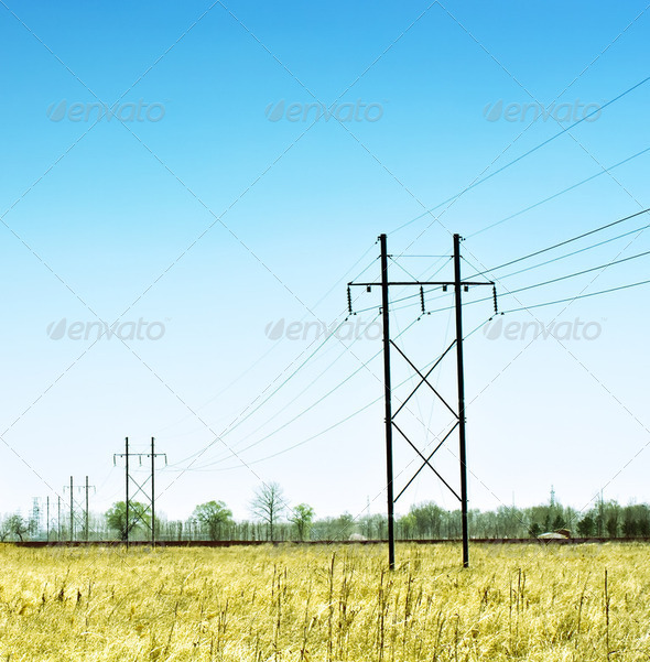 High voltage electrical power line in the field - Stock Photo - Images