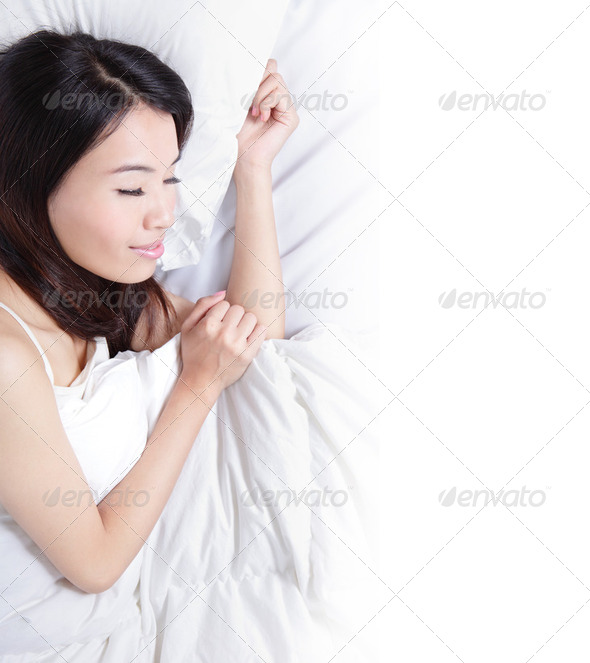 Woman sleeping on the bed in the morning - Stock Photo - Images