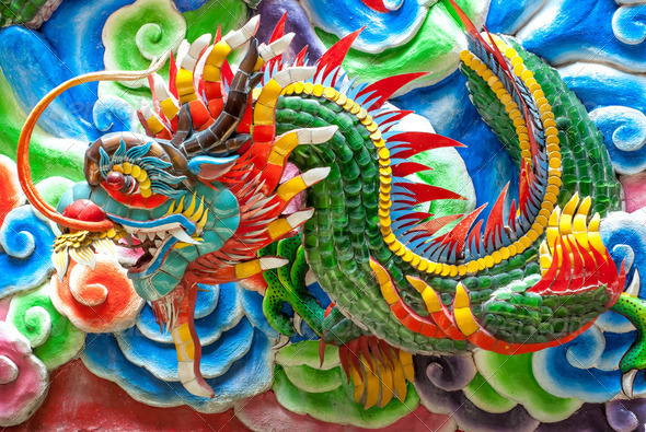chinese dragon statue at the wall of temple, Thailand - Stock Photo - Images
