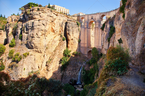 New bridge and falls in Ronda white village. Andalusia, Spain. - Stock Photo - Images